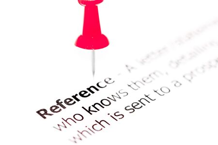 white pushpin: Word REFERENCE  pinned on white paper with red pushpin, available copy space. Business Concept Stock Photo