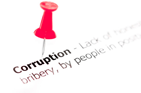 white pushpin: Word CORRUPTION pinned on white paper with red pushpin, available copy space. Business Concept Stock Photo