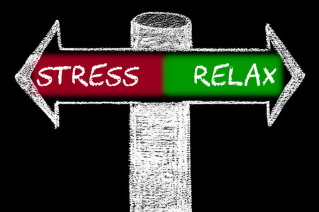 Opposite arrows with Stress versus Relax. Hand drawing with chalk on blackboard. Choice conceptual image photo