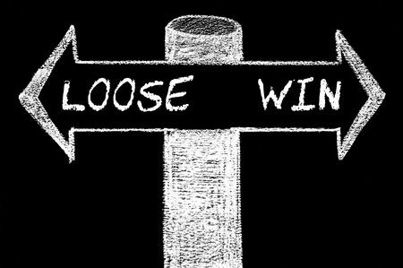 Opposite arrows with Loose versus Win. Hand drawing with chalk on blackboard. Choice conceptual image photo