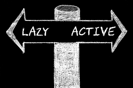 active arrow: Opposite arrows with Lazy versus Active. Hand drawing with chalk on blackboard. Choice conceptual image