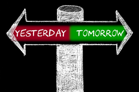 versus: Opposite arrows with Yesterday versus Tomorrow. Hand drawing with chalk on blackboard. Choice conceptual image