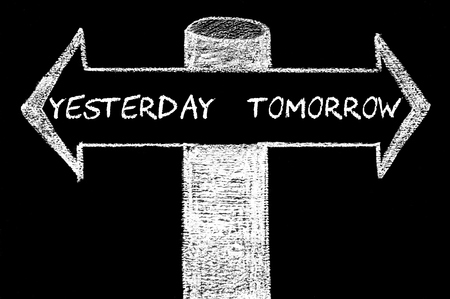 Opposite arrows with Yesterday versus Tomorrow. Hand drawing with chalk on blackboard. Choice conceptual image