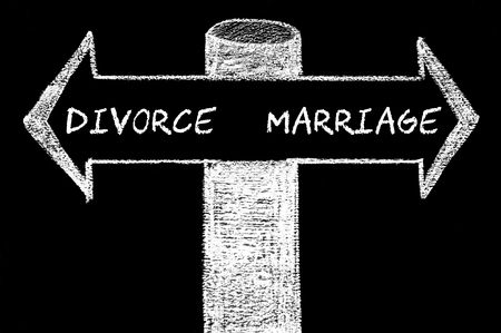 versus: Opposite arrows with Divorce versus Marriage. Hand drawing with chalk on blackboard. Choice conceptual image