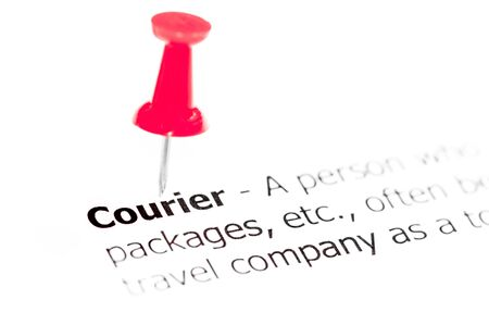 white pushpin: Word COURIER pinned on white paper with red pushpin, available copy space. Business Concept