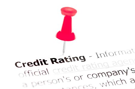 white pushpin: Words CREDIT RATING pinned on white paper with red pushpin, available copy space. Business Concept