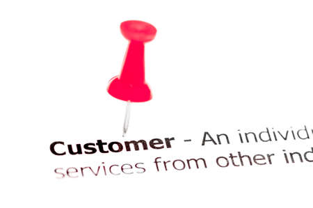 red pushpin: Word CUSTOMER pinned on white paper with red pushpin, available copy space. Business Concept Stock Photo