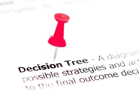 decision tree: Word DECISION TREE pinned on white paper with red pushpin, available copy space. Business Concept