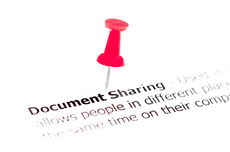 red pushpin: Words DOCUMENT SHARING pinned on white paper with red pushpin, available copy space. Business Concept
