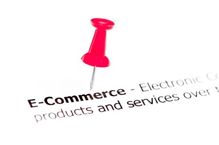 red pushpin: Word E-Commerce pinned on white paper with red pushpin, available copy space. Business Concept