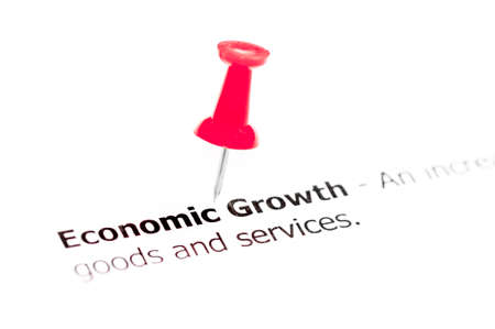white pushpin: Word Economic Growth pinned on white paper with red pushpin, available copy space. Business Concept Stock Photo