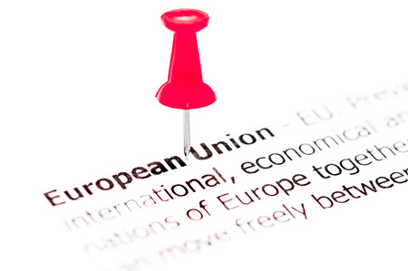 white pushpin: Words EUROPEAN UNION pinned on white paper with red pushpin, available copy space. Business Concept
