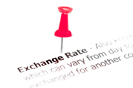 exchange rate: Words EXCHANGE RATE pinned on white paper with red pushpin, available copy space. Business Concept