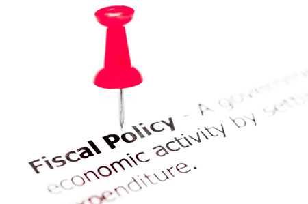 white pushpin: Words FISCAL POLICY pinned on white paper with red pushpin, available copy space. Business Concept