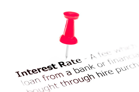 white interest rate: Words INTEREST RATE pinned on white paper with red pushpin, available copy space. Business Concept