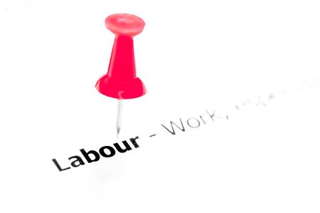 white pushpin: Word LABOUR pinned on white paper with red pushpin, available copy space. Business Concept Stock Photo