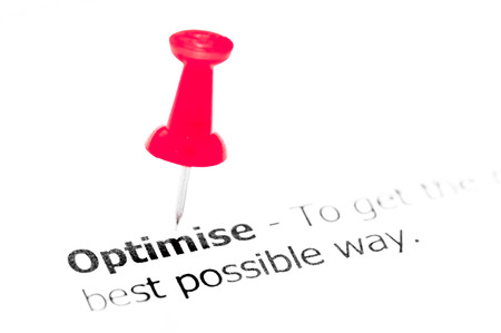 red pushpin: Word OPTIMISE  pinned on white paper with red pushpin, available copy space. Business Concept