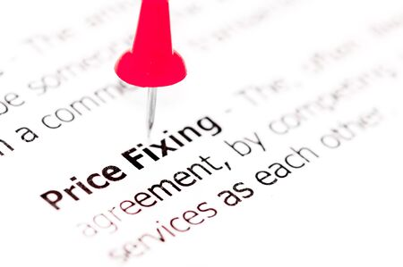 red pushpin: Words PRICE FIXING pinned on white paper with red pushpin, available copy space. Business Concept