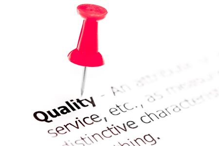 white pushpin: Word QUALITY pinned on white paper with red pushpin, available copy space. Business Concept Stock Photo