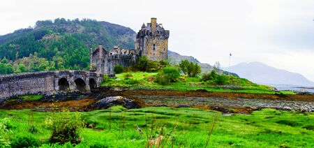 lochs: Panoramic view of famous Eilean Donan Castle in Scotland, UK. Situated on a small isle at the meeting point of three sea lochs - Loch Long, Loch Duich and Loch Alsh, is one of the most iconic images of Scotland.