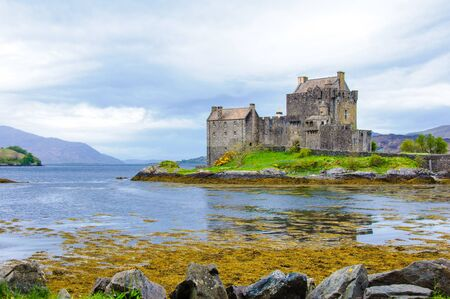 Famous Eilean Donan Castle in Scotland, UK. Situated on a small isle at the meeting point of three sea lochs - Loch Long, Loch Duich and Loch Alsh, is one of the most iconic images of Scotland. photo