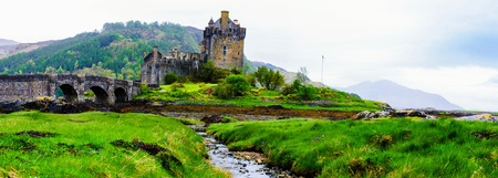 highlands region: Panoramic view of famous Eilean Donan Castle in Scotland, UK. Situated on a small isle at the meeting point of three sea lochs - Loch Long, Loch Duich and Loch Alsh, is one of the most iconic images of Scotland.