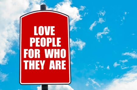 they: Love People For Who They Are motivational quote written on red road sign isolated over clear blue sky background. Concept  image with available copy space Stock Photo