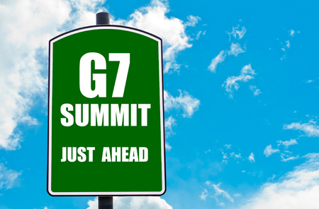 just ahead: G7 SUMMIT Just Ahead written on green road sign  against clear blue sky background. Concept image with available copy space