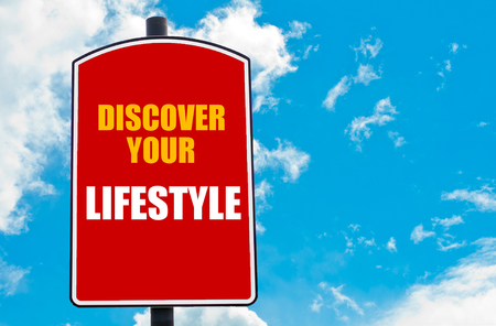 discover: Discover Your Lifestyle motivational quote written on red road sign isolated over clear blue sky background. Concept  image with available copy space