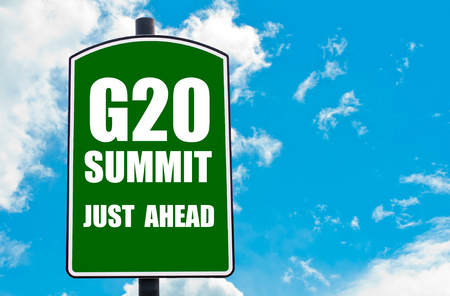 just ahead: G20 SUMMIT Just Ahead written on green road sign  against clear blue sky background. Concept image with available copy space