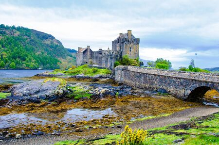 man made structure: Famous Eilean Donan Castle in Scotland, UK. Situated on a small isle at the meeting point of three sea lochs - Loch Long, Loch Duich and Loch Alsh, is one of the most iconic images of Scotland.