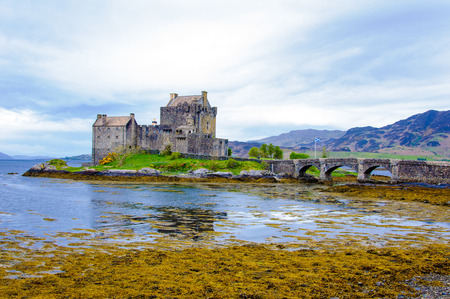 Famous Eilean Donan Castle in Scotland, UK. Situated on a small isle at the meeting point of three sea lochs - Loch Long, Loch Duich and Loch Alsh, is one of the most iconic images of Scotland.