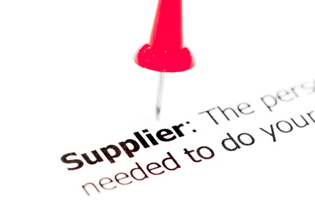 red pushpin: Word SUPPLIER  pinned on white paper with red pushpin, available copy space. Business Concept