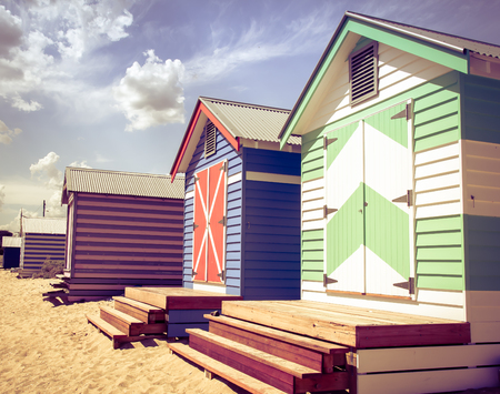 st kilda: Bathing houses at Brighton Beach, Australia. View of colorful beach huts with retro color filter applied, summer vacation concept