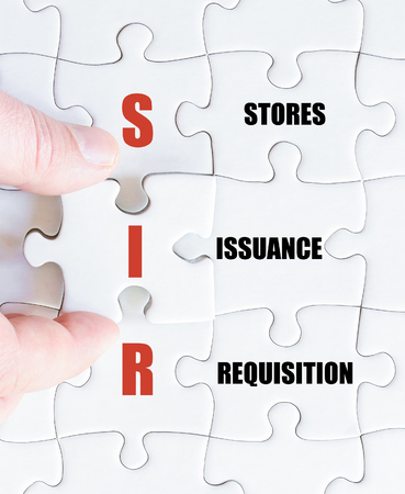 requisition: Hand of a business man completing the puzzle with the last missing piece.Concept image of Business Acronym SIR as Stores Issuance Requisition