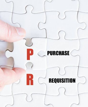 requisition: Hand of a business man completing the puzzle with the last missing piece.Concept image of Business Acronym PR as Purchase Requisition