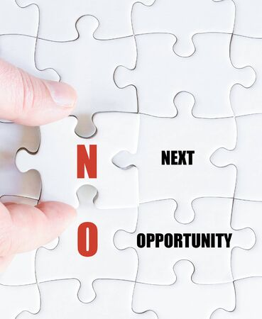 Hand of a business man completing the puzzle with the last missing piece.Concept image of Business Acronym NO as Next Opportunity