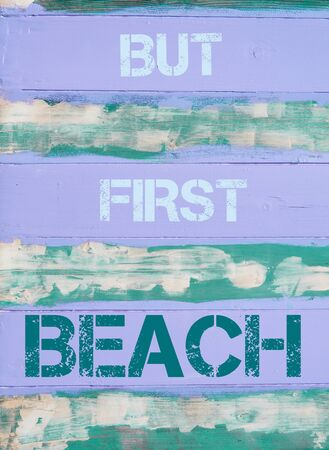 but: Concept image of BUT FIRST BEACH motivational quote written on vintage painted wooden wall Stock Photo