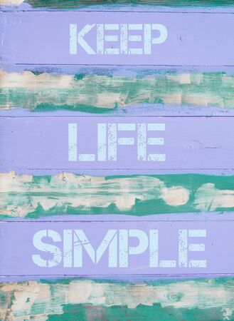 simple life: Concept image of KEEP LIFE SIMPLE  motivational quote written on vintage painted wooden wall