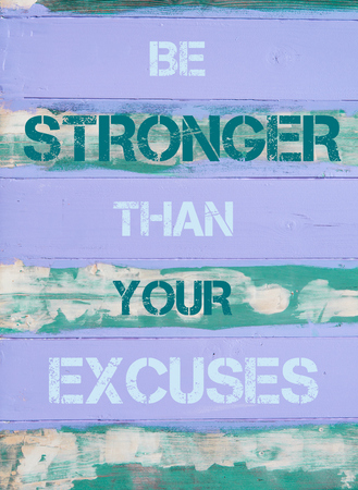 stronger: Concept image of BE STRONGER THAN YOUR EXCUSES  motivational quote written on vintage painted wooden wall