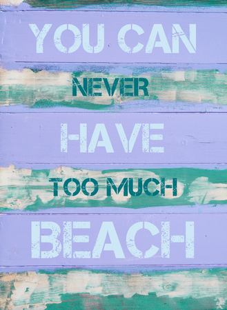 too much: Concept image of YOU CAN NEVER HAVE TOO MUCH BEACH  motivational quote written on vintage painted wooden wall