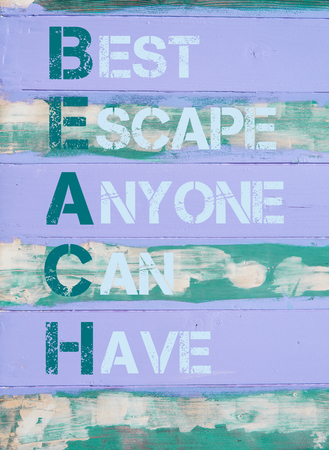 Concept image of BEACH Acronym as Best Escape Anyone Can Have written on vintage painted wooden wall