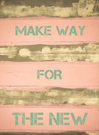 Concept image of MAKE WAY FOR THE NEW  motivational quote written on vintage painted wooden wall photo