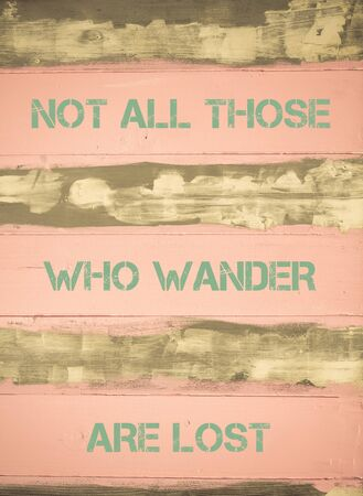 those: Concept image of NOT ALL THOSE WHO WANDER ARE LOST motivational quote written on vintage painted wooden wall