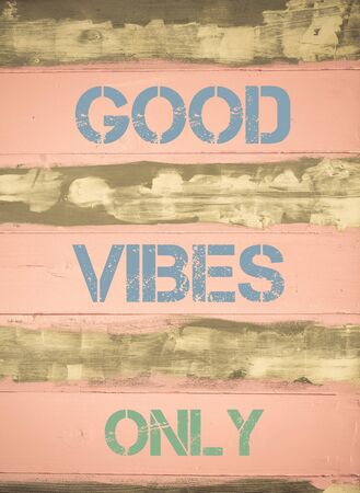 good idea: Concept image of GOOD VIBES ONLY  motivational quote written on vintage painted wooden wall Stock Photo