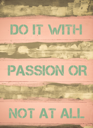 not painted: Concept image of DO IT WITH PASSION OR NOT AT ALL motivational quote written on vintage painted wooden wall
