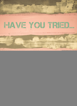tried: Concept image of HAVE YOU TRIED THE BEACH THERAPY? motivational quote written on vintage painted wooden wall Stock Photo