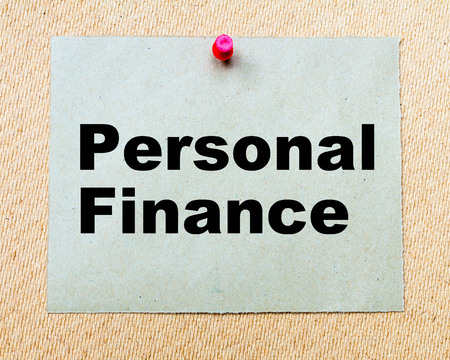 personal finance: Personal Finance written on paper note pinned with red thumbtack on wooden board. Business conceptual Image
