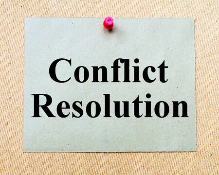 resolution: Conflict Resolution written on paper note pinned with red thumbtack on wooden board. Business conceptual Image
