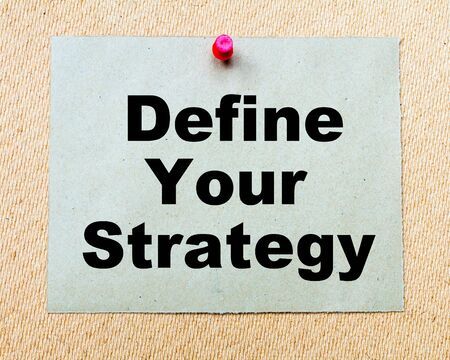 define: Define Your Strategy  written on paper note pinned with red thumbtack on wooden board. Business conceptual Image